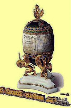 Trans-Siberian railway egg. presented to Alexandra Feodorovna by Nicholas II probably 1901. Silver band has engraved map of route of railway in 1900. Train runs when wound up by key. | Ron Purcell приколол(а) это к доске Eggs